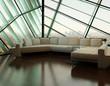 Beige couch against extravagant design window