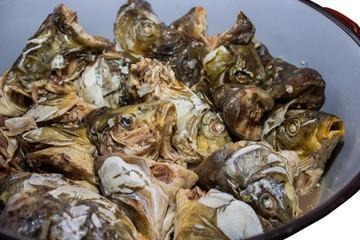 Boiled carp heads in saucepan 3