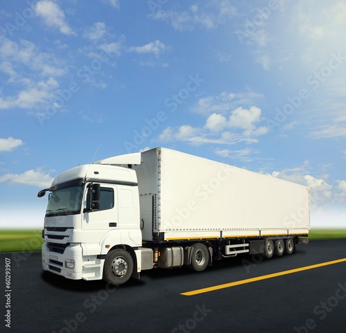 White cargo truck on the road