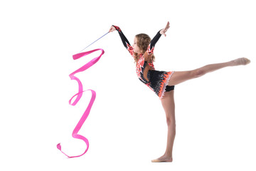 Harmonous artistic gymnast dancing in studio
