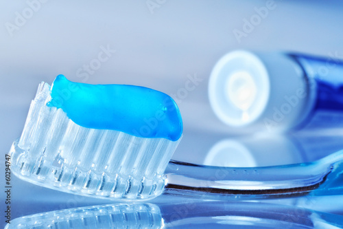 toothbrush and toothpaste tube on the table - 60294747