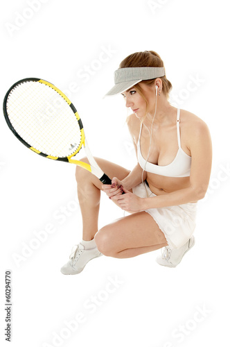 Female tennis player holding  racket, isolated on white backgrou