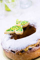 Easter ring cake with icing sugar and colorful butterfly