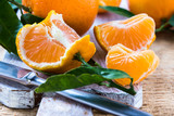 Fresh ripe mandarines  clementines with leaves