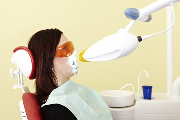 Woman taking care in dental clinic