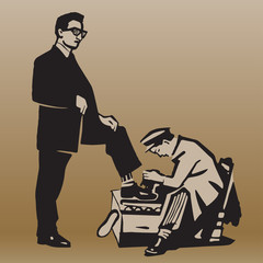 Boy cleans shoes to respectable man