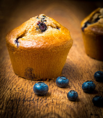 Blueberry muffins isolated on wood table