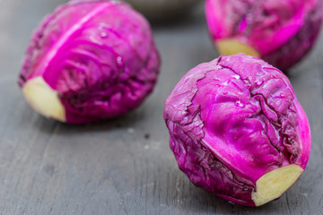 Red cabbage on wooden background close up shoot