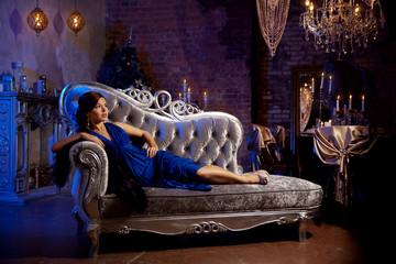Luxury fashion stylish woman in the rich interior. Beautiful gir
