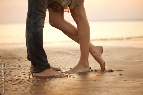 A loving young couple hugging and kissing on the beach. Lovers m - 60299108