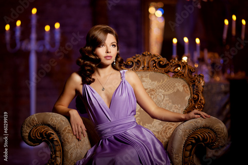Luxury fashion stylish woman in the rich interior. Beautiful gir