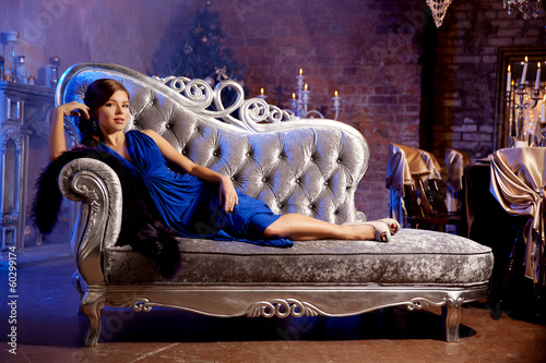 Luxury fashion stylish woman in the rich interior. Beauty girl w