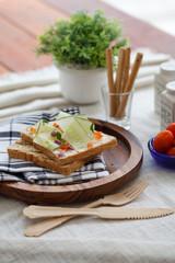 Freshly made sanwich on wooden cutting board