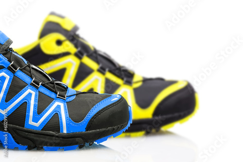 Trekking shoes isolated on white background