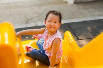 little girl smiling on slider
