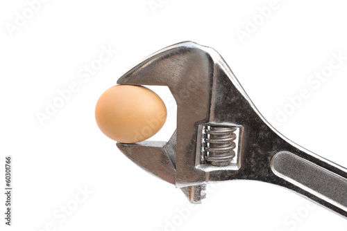 egg and wrench on white with clipping path