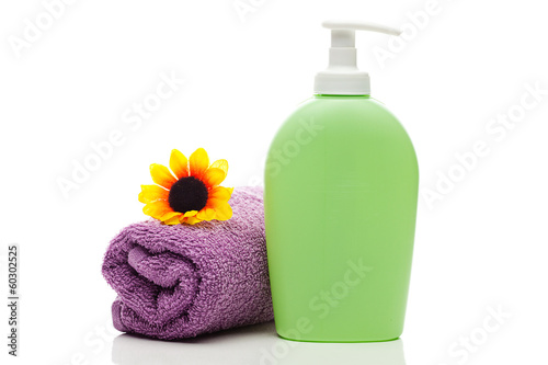 cosmetic containers,towel and sunflower isolated on white