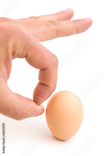 finger kicking an egg with clipping path