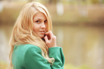 portrait of the blonde girl in the autumn park