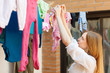 girl drying clothes  after laundry