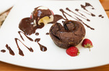 Chocolate fondant cake with strawberries and ice-cream
