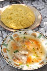 Moldovan traditional soup zama with mamaliga