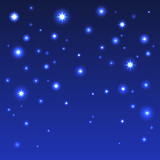 Holiday background with shiny stars in the dark blue sky