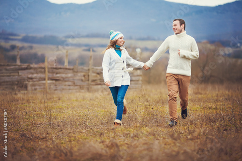 Young couple walking together while enjoying a day in park