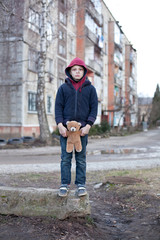 homeless boy with bear