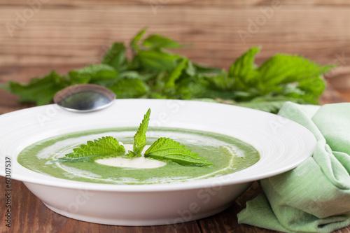 Fototapeta Nettle cream soup with sour cream