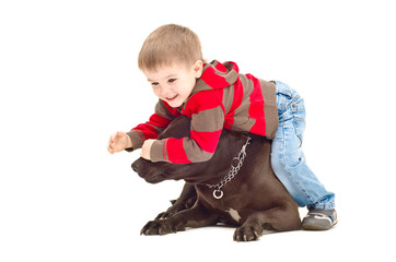 Child playing with dog closes her eyes