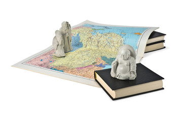Buddhist figurines and a map of China