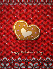 Heart gingerbread cookie on knitted background