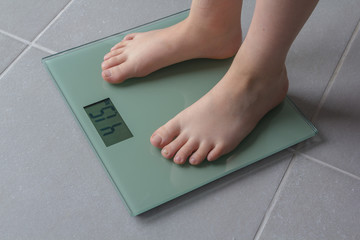 child weighing up