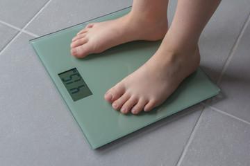 child weighing up