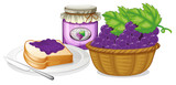 A basket of grapes, jam and a sandwich