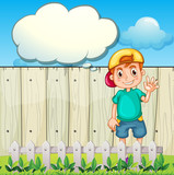 A young boy with an empty thought standing near the fence