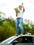Woman on top of a car looking for the right way