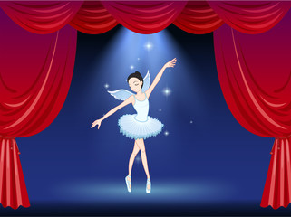 A stage with a ballerina dancer