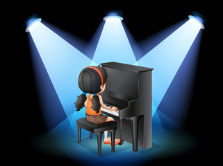 A talented young girl playing with the piano