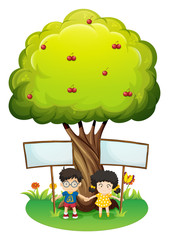 Kids under the tree with empty signboards