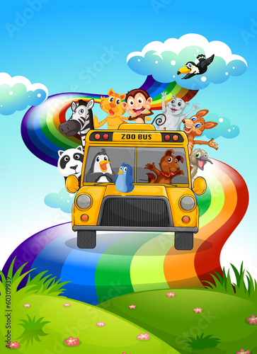 A zoo bus travelling through the rainbow road