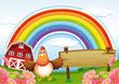 A farm with an empty wooden board and a rainbow above