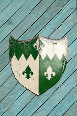 Heraldic shield on wooden background