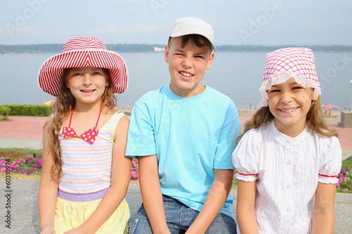 Three cheerful children: boy and two girl