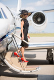 Wealthy Woman Disembarking Private Jet At Airport Terminal poster