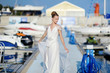 Beautiful bride posing in a harbor
