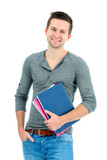 Smiling teenager with schoolbooks and hand in pocket poster