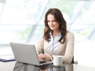 Beautiful business woman with laptop