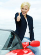 Woman shows thumbs up for driving enjoyment